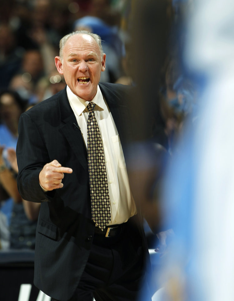 Denver Nuggets head coach George Karl directs his squad against the Los Angeles Lakers in the first quarter of Game 4 of the teams' first-round NBA basketball series in Denver on Sunday, May 6, 2012. (AP Photo/David Zalubowski)