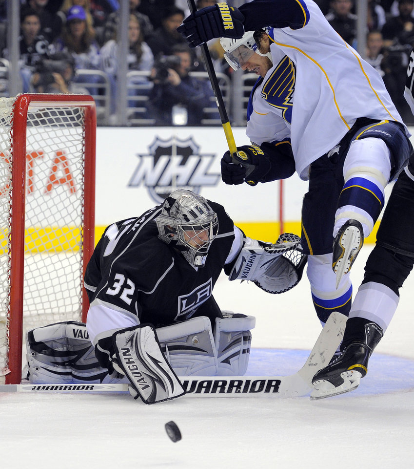 Photo -   Los Angeles Kings goalie Jonathan Quick, left, stops a shot by St. Louis Blues left wing Alexander Steen during the third period in Game 4 of an NHL hockey Stanley Cup second-round playoff series, Sunday, May 6, 2012, in Los Angeles. The Kings won 3-1 to win the series 4-0. (AP Photo/Mark J. Terrill)