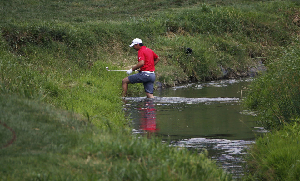 Photo - Jason Day, of Australia, crosses the water on the second hole during the third round of the PGA Championship golf tournament at Valhalla Golf Club on Saturday, Aug. 9, 2014, in Louisville, Ky. (AP Photo/Mike Groll)