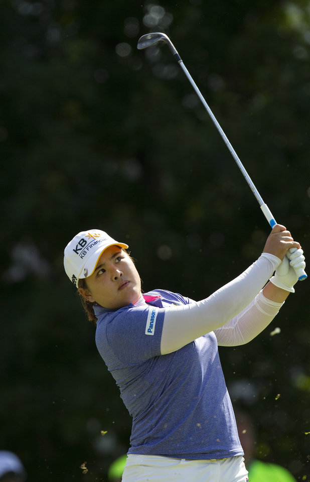 Photo - Inbee Park, of South Korea, watches her ball from the 16th tee box during the final round of the LPGA NW Arkansas Championship golf tournament on Sunday, June 23, 2013, in Rogers, Ark. (AP Photo/Beth Hall)