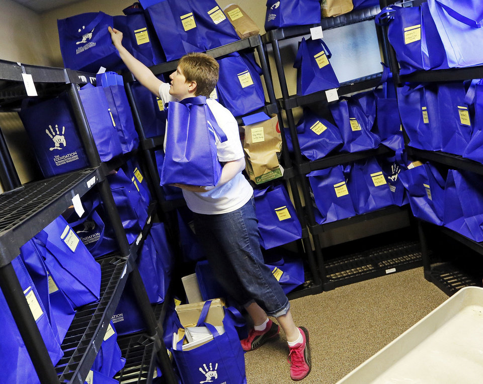 Chief Programs Officer Robyn Hilger gathers bags of school supplies being picked up for an elementary school at the Foundation for Oklahoma City Public Schools. The foundation, through its Teachers Warehouse program, recently reached the $1 million mark for giving away school supplies. Photo by Nate Billings, The Oklahoman <strong>NATE BILLINGS - THE OKLAHOMAN</strong>