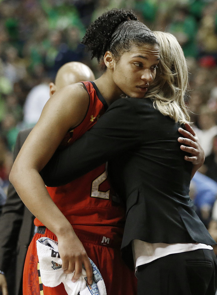 Photo - Maryland forward Alyssa Thomas (25) embraces a member of the Maryland team during the second half of the semifinal game against Notre Dame in the Final Four of the NCAA women's college basketball tournament, Sunday, April 6, 2014, in Nashville, Tenn. Notre Dame won 87-61. (AP Photo/John Bazemore)