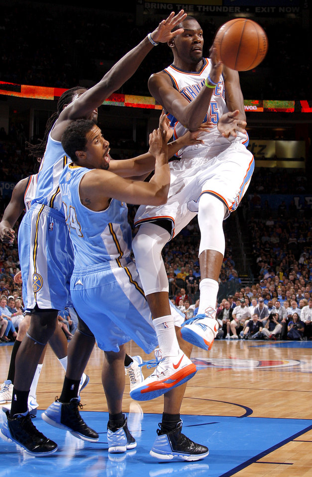 Photo - Oklahoma City's Kevin Durant (35) passes the ball beside Denver's Al Harrington, left, and Andre Miller during the NBA basketball game between the Oklahoma City Thunder and the Denver Nuggets at Chesapeake Energy Arena in Oklahoma City, Wednesday, April 25, 2012. Photo by Bryan Terry, The Oklahoman