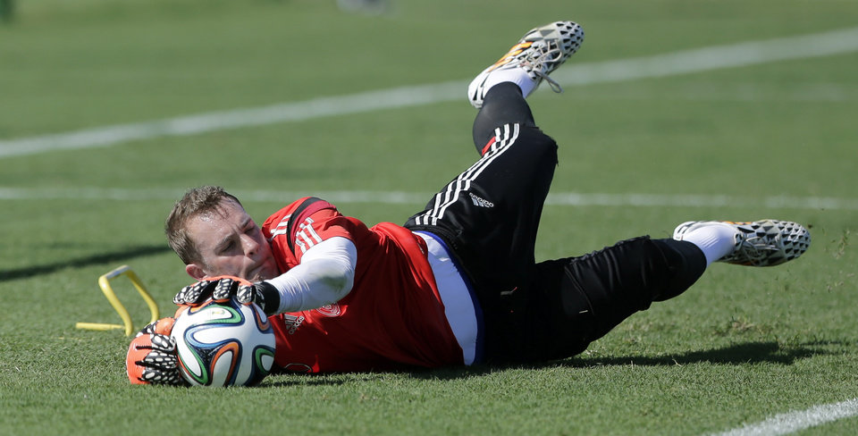 Photo - Germany national soccer goalkeeper Manuel Neuer catches a ball during a training session in Santo Andre near Porto Seguro, Brazil, Wednesday, June 11, 2014. Germany will play in group G of the 2014 soccer World Cup. (AP Photo/Matthias Schrader)