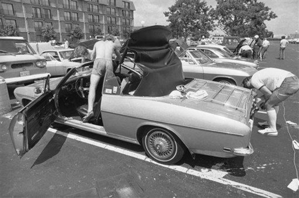 "Nearly 1,000 Corvair owners came to the Corvair Society of America (CORSA) convention in Bloomington, Minn., where they displayed and talked about the car consumer advocate Ralph Nader called ""unsafe at any speed."" Two Corvair enthusiasts work on the convention's motel parking lot in Bloomington, July 30, 1977. (AP Photo/Jim Mone)"