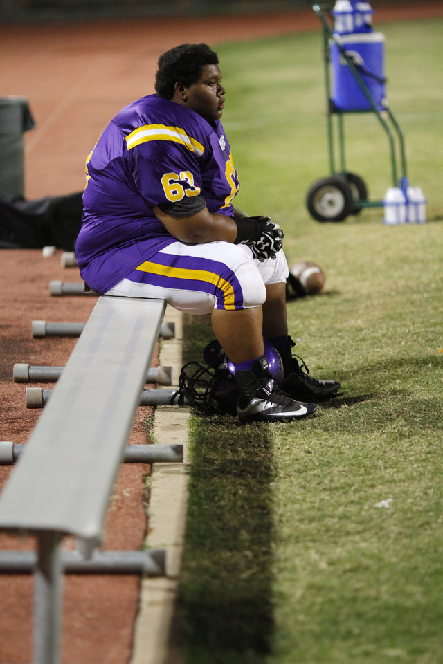 NWC's Darius Bias rests on bench at the Northwest Classen vs. Western Heights high school football game at Taft Stadium Thursday, September 20, 2012. Photo by Doug Hoke, The Oklahoman