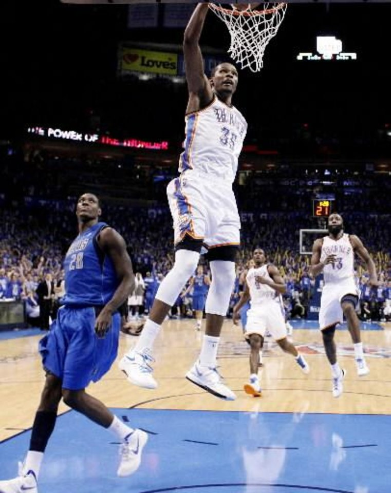Oklahoma City's Kevin Durant (35) dunks the ball in front of Dallas' Ian Mahinmi (28) during game one of the first round in the NBA playoffs between the Oklahoma City Thunder and the Dallas Mavericks at Chesapeake Energy Arena in Oklahoma City, Saturday, April 28, 2012. (Photo by Sarah Phipps, The Oklahoman)