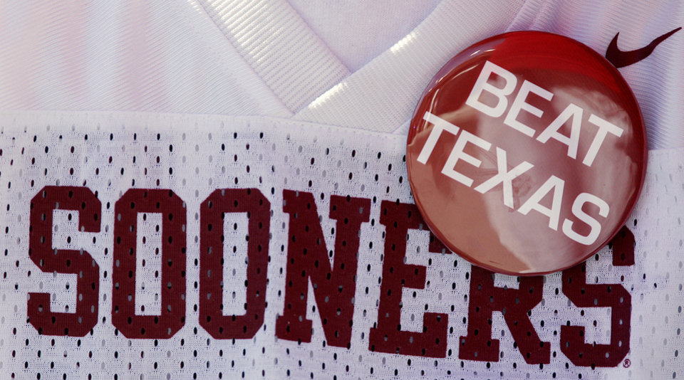 Photo - Sooner fans show support for the team during the Red River Rivalry college football game between the University of Oklahoma Sooners (OU) and the University of Texas Longhorns (UT) at the Cotton Bowl in Dallas, Texas, Saturday, Oct. 17, 2009. Photo by Chris Landsberger, The Oklahoman