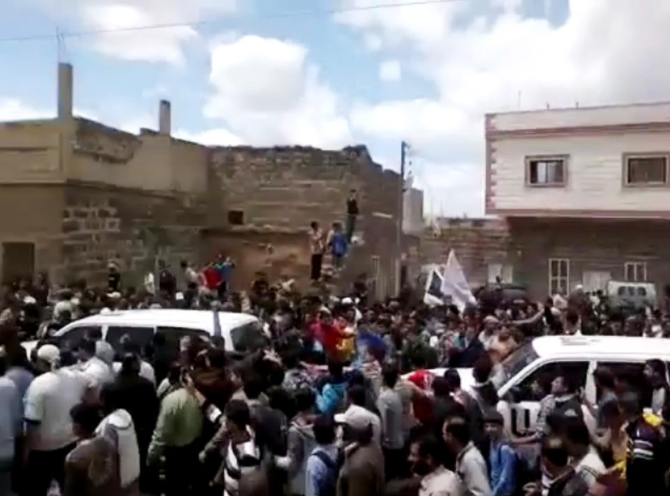 Photo -   In this image made from amateur video released by the Shaam News Network and accessed Thursday, April 19, 2012, Syrians surround UN vehicles during a demonstration in Daraa, Syria. In Syria on Thursday, activists said regime forces took control of a southern town and shot at activists in another soon after international observers left. Protesters chanted anti-government slogans for the observers to hear. (AP Photo/Shaam News Network via AP video) TV OUT, THE ASSOCIATED PRESS CANNOT INDEPENDENTLY VERIFY THE CONTENT, DATE, LOCATION OR AUTHENTICITY OF THIS MATERIAL