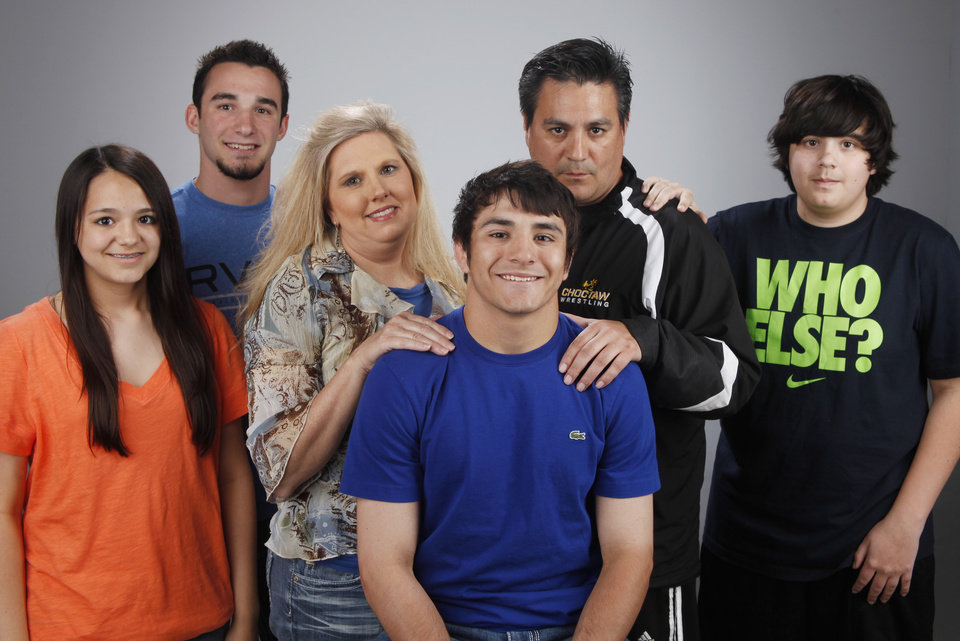HIGH SCHOOL WRESTLING / JULIE GARCIA / ANGELA GARCIA / BRIAN GARCIA / BLAKE GARCIA / FAMILY: All-City Wrestler Kyle Garcia with family members, from left, Julie, Eric Waggoner (cousin), Angela, Brian and Blake at OPUBCO studio Monday April 2, 2012. Photo by Doug Hoke, The Oklahoman