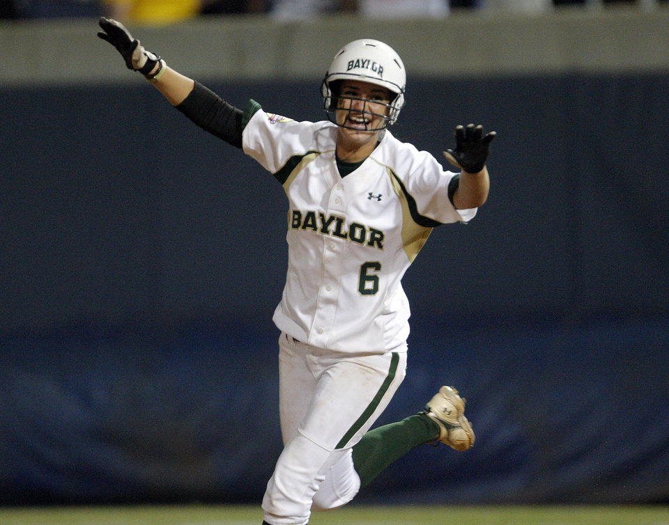 Photo - Baylor's Holly Holl (6) celebrates a walk-off homer un in the 13th inning during the Women's College World Series game between Baylor and Missouri at the ASA Hall of Fame Stadium in Oklahoma City, Sunday, June 5, 2011. Photo by Sarah Phipps, The Oklahoman
