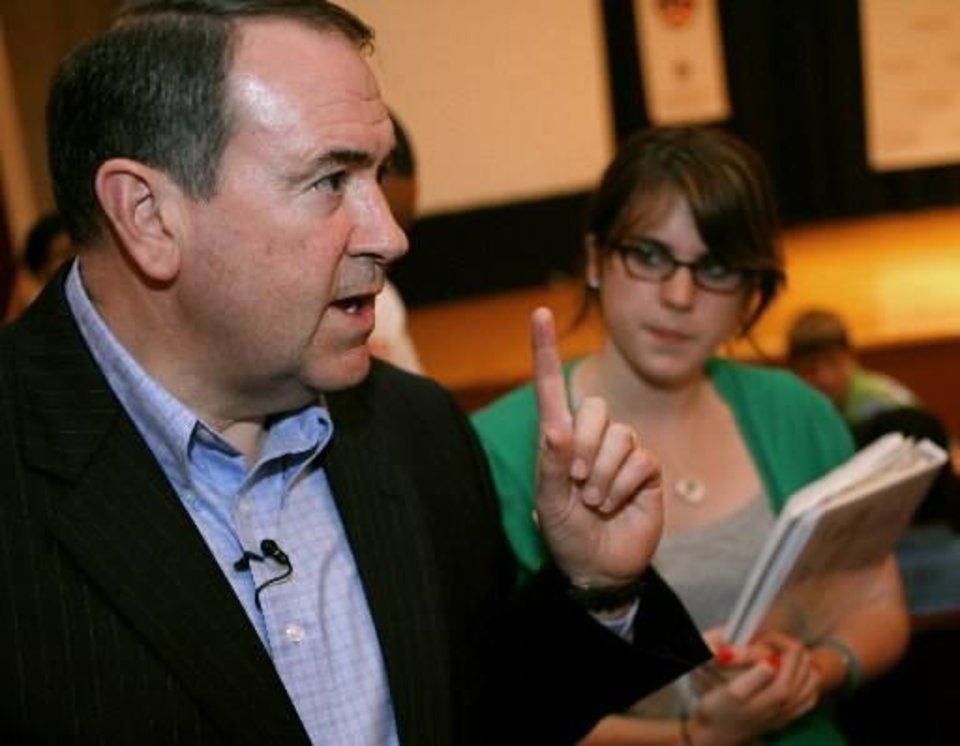 Photo - Michela Smith, a student from Andover, Mass., listens to Former Arkansas Governor  Mike  Huckabee as he speaks to high school students at Oklahoma Christian University in Edmond on Sunday, July 12, 2008. By John Clanton