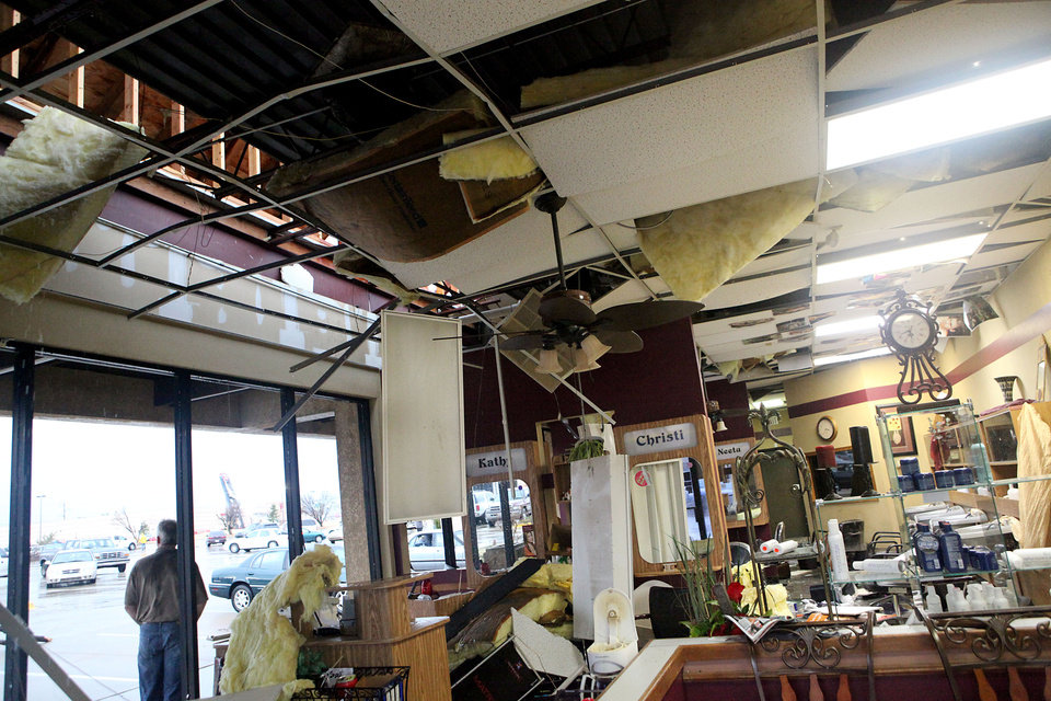 Photo - Damage to a Fantastic Sams following storms  in Oklahoma City on Tuesday, Feb. 10, 2009. By John Clanton, The Oklahoman