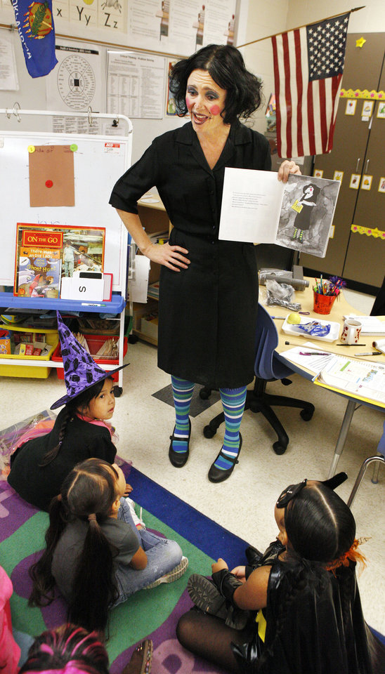 """Photo - Kindergarten teacher Tammy Ketch is dressed as the character Miss Viola Swamp from the book """"Miss Nelson Is Missing"""" while reading to students."""