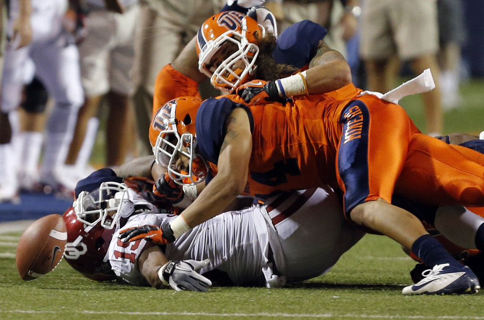 Oklahoma Sooners wide receiver Justin Brown (19) fumbles the ball after being brought down by the UTEP defense during the college football game between the University of Oklahoma Sooners (OU) and the University of Texas El Paso Miners (UTEP) at Sun Bowl Stadium on Saturday, Sept. 1, 2012, in El Paso, Tex. Photo by Chris Landsberger, The Oklahoman