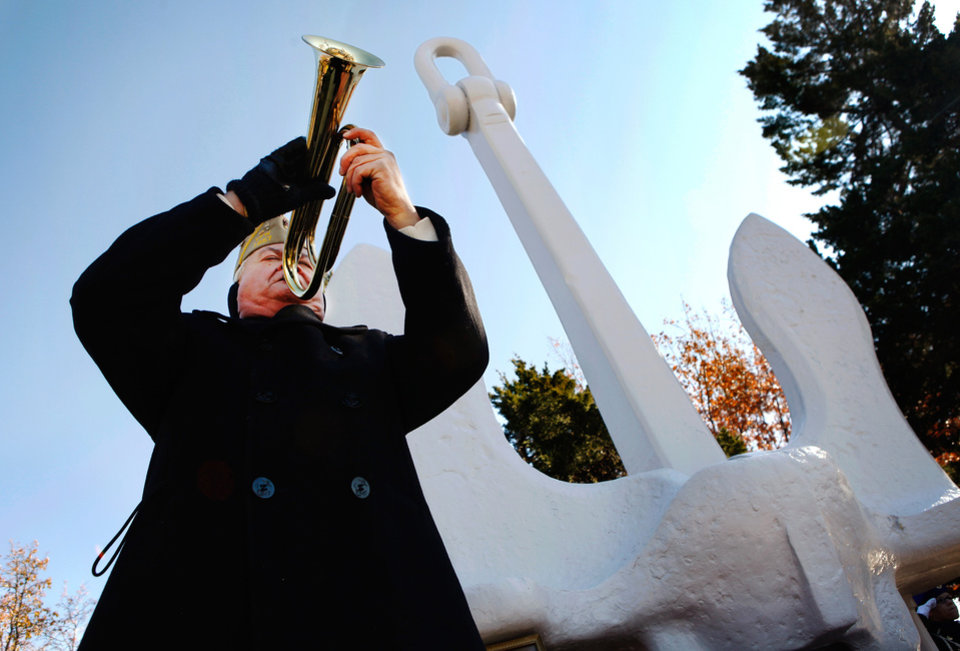Photo - George Morris  plays taps  near the end of  a ceremony Wednesday, Dec. 7, 2011, near NW 13 and Broadway in Oklahoma City,  to commemorate the 70th anniversary of the Japanese attack on US forces at Pearl Harbor in 1941. The memorial was held  in front of the anchor salvaged  from the USS Oklahoma after it sank.  Morris, who served in the US Air Force,  is a past post commander at VFW Post 1857.   Photo by Jim Beckel, The Oklahoman