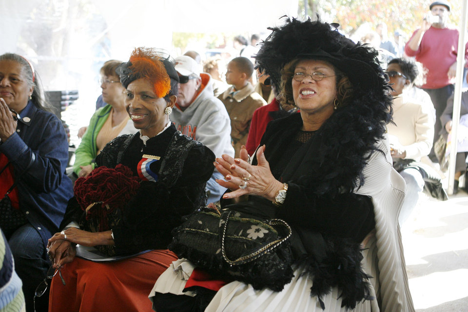 Photo - Evelyn Nephew with the Guthrie City Council, and Lola King, Education Officer with Tinker Air Force Base, watch a short play, one of several African American Statehood Events at E.B. McCable theatre, during the Centennial Day celebrations in Guthrie, OK, Thursday, Nov. 16, 2007. By Paul Hellstern / The Oklahoman  ORG XMIT: KOD