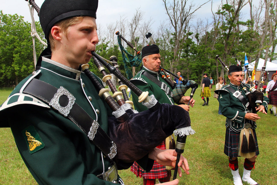 Photo - Todd Moran, John Powell and Jim Jewell of the Pipes and Drums of the Highlands of Oklahoma City perform during the Iron Thistle Festival in Yukon, Saturday, April 28th, 2012. PHOTO BY HUGH SCOTT, FOR THE OKLAHOMAN   ORG XMIT: KOD