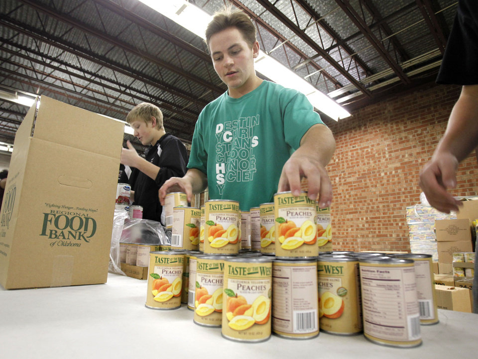 Jacob Rookard packs boxes as he and other students from Destiny Christian School volunteer at the City Rescue Mission in Oklahoma City, OK, Monday, Nov. 14, 2011. The Mission is gathering food and donations for its Thanksgiving food delivery. By Paul Hellstern, The Oklahoman