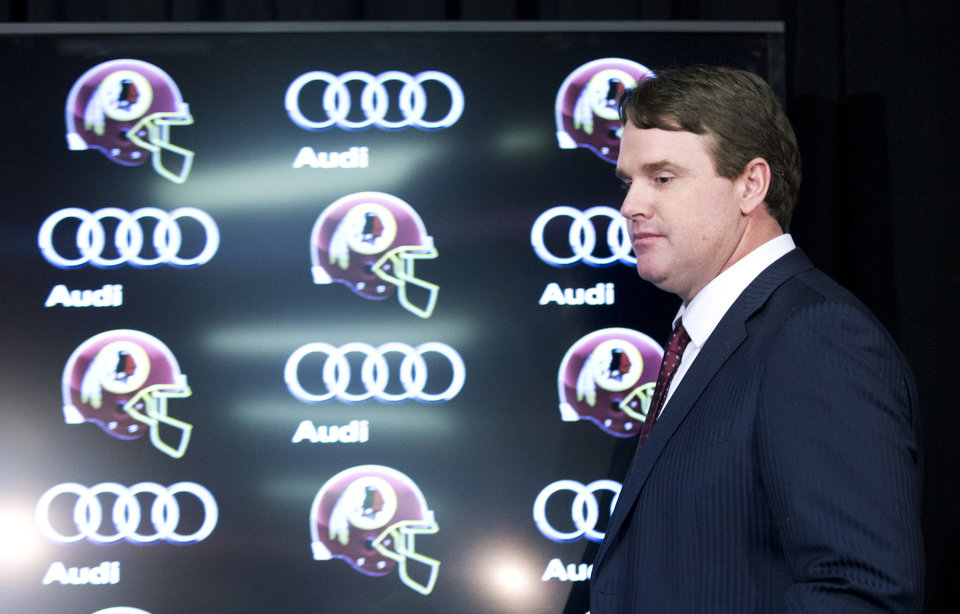 Photo - New Washington Redskins head coach Jay Gruden, arrives for a news conference at the Redskins Park in Ashburn, Va., Thursday, Jan. 9, 2014.  Jay Gruden was introduced Thursday as the new Washington Redskins head coach, replacing Mike Shanahan and becoming the team's eighth head coach since Daniel Snyder purchased the franchise in 1999. (AP Photo/Manuel Balce Ceneta)
