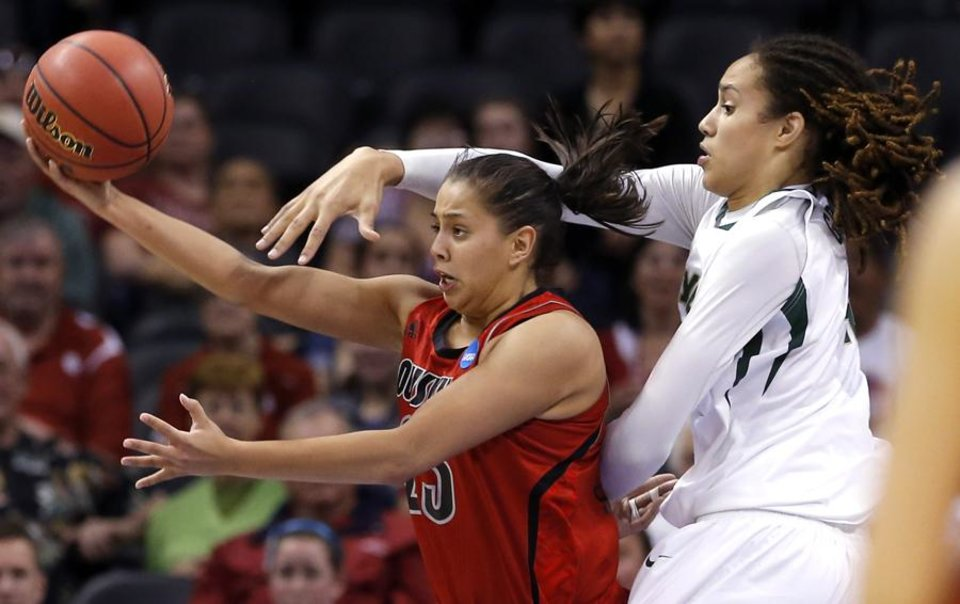 Louisville's Shoni Schimmel (23) makes a shot as Baylo's Brittney Griner (42) defends during college basketball game between Baylor University and the Louisville at the Oklahoma City Regional for the NCAA women's college basketball tournament at Chesapeake Energy Arena in Oklahoma City, Sunday, March 31, 2013. Photo by Sarah Phipps, The Oklahoman
