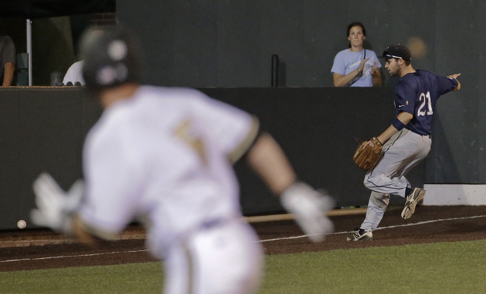 Photo - Xavier outfielder Patrick Jones (21) chases down a double by Vanderbilt's Bryan Reynolds as Vanderbilt's Jason Delay, left, advances to third during the fourth inning of an NCAA college baseball tournament regional game Friday, May 30, 2014, in Nashville, Tenn. (AP Photo/Mark Humphrey)