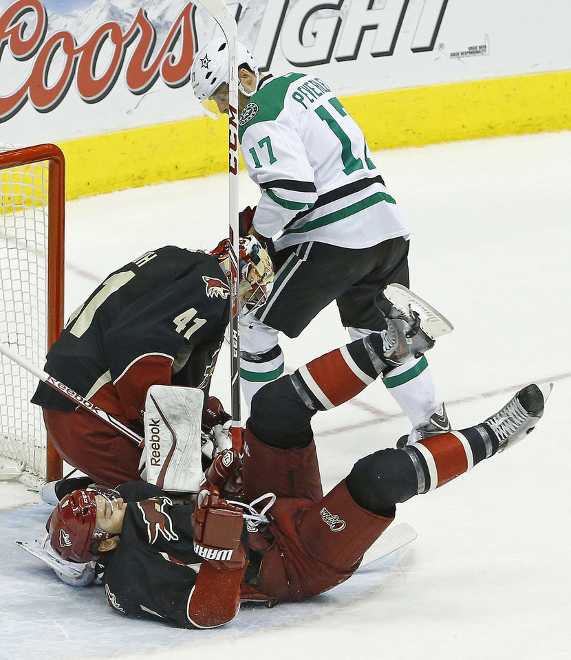 Photo - hoenix Coyotes goalie Mike Smith (41) and Zbynek Michalek stop a shot by Dallas Stars center Rich Peverley (17) during the second period of their NHL game, Tuesday, Feb. 4, 2014 in Glendale, Ariz. (AP Photo/The Arizona Republic, David Kadlubowski)