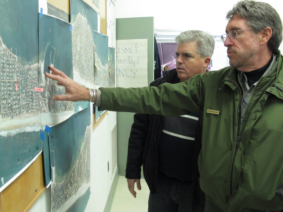 Photo -   In this Friday, Nov. 16, 2012 photo, Chris Soller, right, superintendent of the Fire Island National Seashore, points to a map of Fire Island with Suffolk County Executive Steve Bellone, in Kismet, N.Y. The two were among a team of officials touring the damaged barrier island south of Long Island. (AP Photo/Frank Eltman)