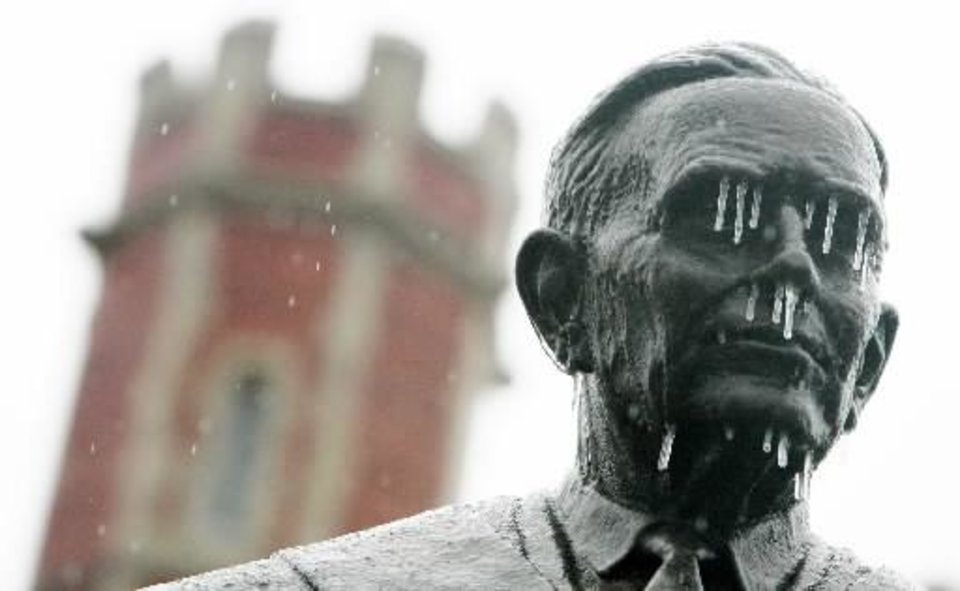 Photo - Ice on the statue of former OU president George Cross in front of Evans Hall on the North Oval of the University of Oklahoma Campus Sunday, Dec. 9, 2007 in Norman,OK. BY JACONNA AGUIRRE