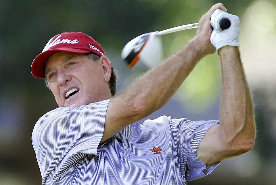 Photo - Gil Morgan hits the shot of the fifth tee during practice rounds for the U.S. Senior Open golf tournament at Oak Tree National in Edmond, Okla. on Monday, July 7, 2014. Photo by Chris Landsberger, The Oklahoman
