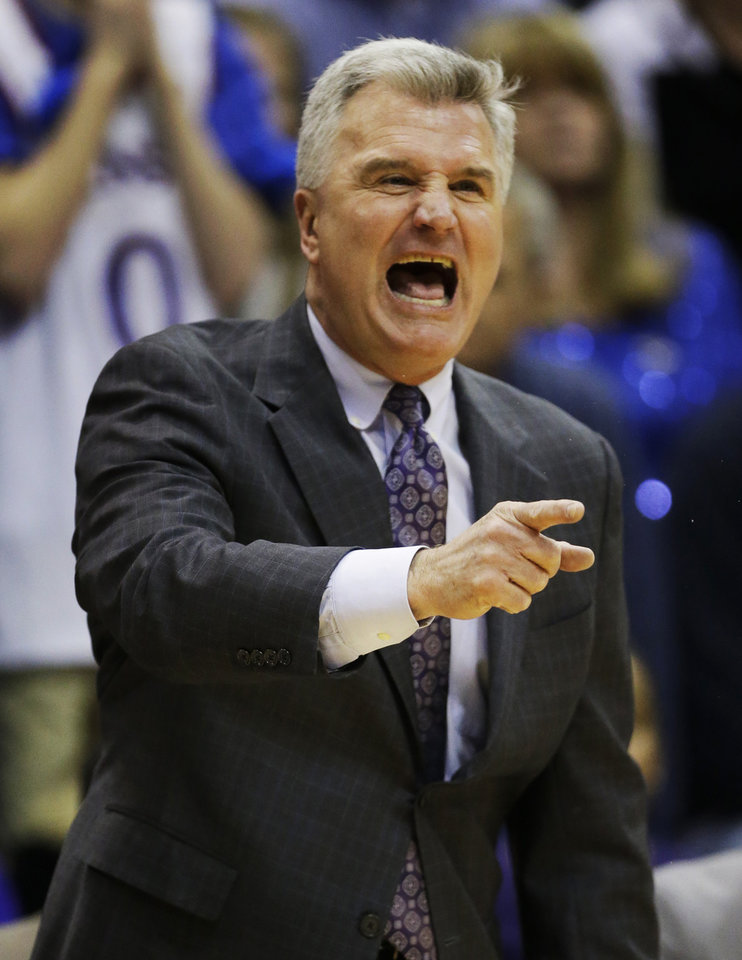 Photo - Kansas State head coach Bruce Weber yells to his team during the first half of an NCAA college basketball game against Kansas in Lawrence, Kan., Monday, Feb. 11, 2013. (AP Photo/Orlin Wagner)
