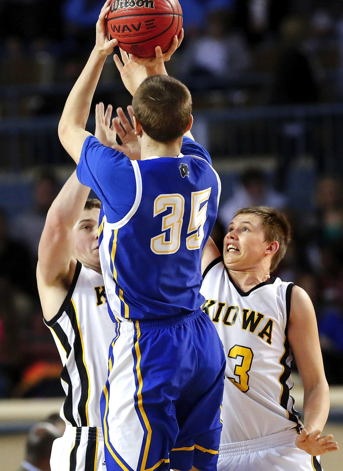 Photo - Despite being double-teamed by Kiowa defenders, Glencoe shooter Ty Lazenby still managed to score 37 points during the Panthers' win during Class A boys high school basketball championship game in the Jim Norick Arena at State Fair Park on  Saturday, March 8, 2014. Kiowa #3 is Clay Doyle. Glencoe defeated Kiowa, 57-39. Photo by Jim Beckel, The Oklahoman