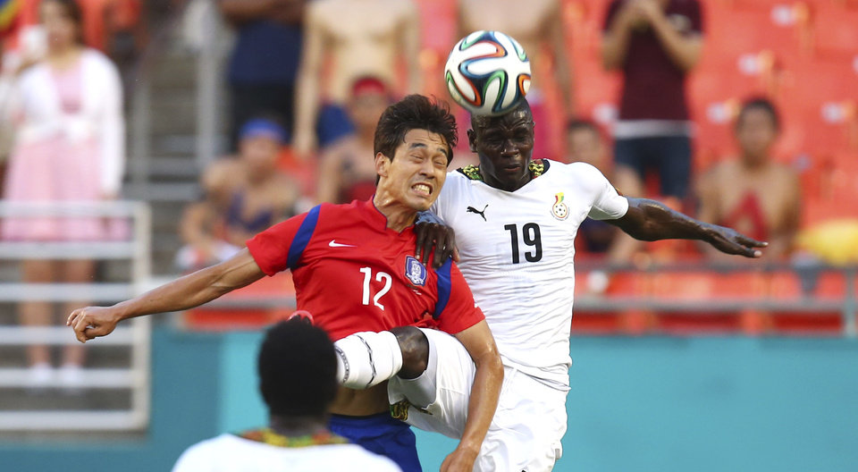 Photo - South Korea's Chu Young Park (12) and Ghana' Jonathan Mensah (19) battle for the ball during the first half of an international  friendly soccer match in Miami Gardens, Fla., Monday, June 9, 2014. ( AP Photo/J Pat Carter)