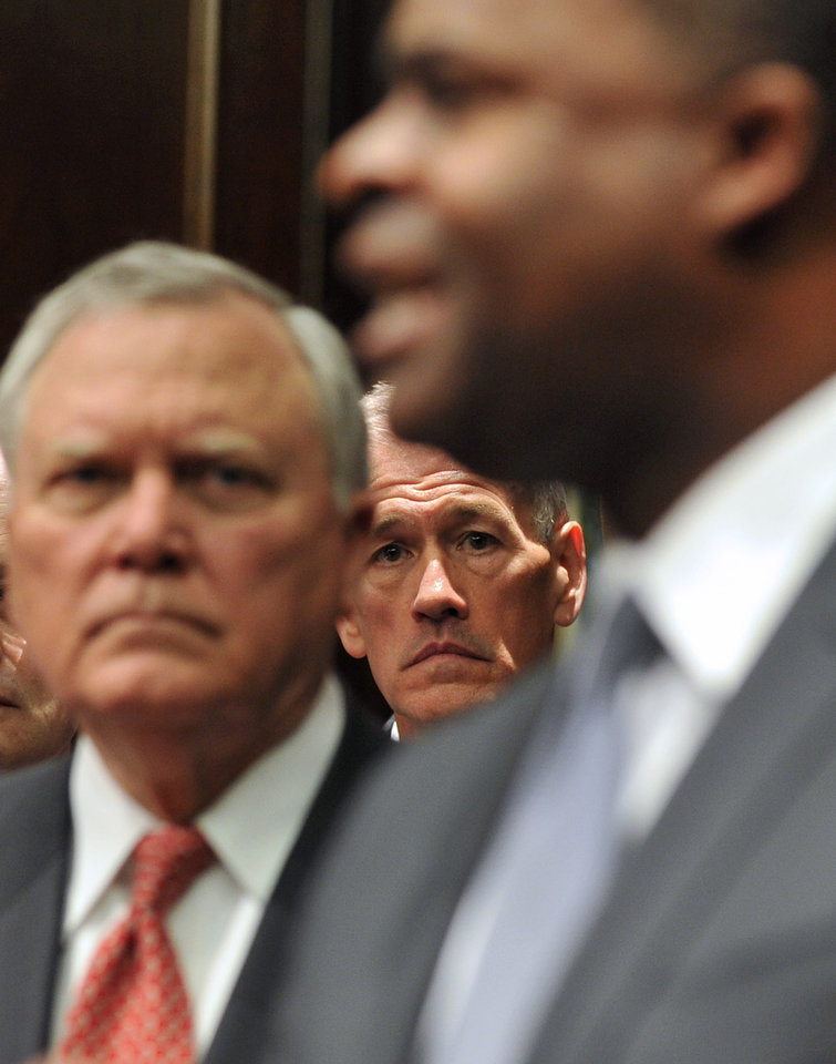 Photo - Georgia Emergency Management Director Charley English, center, and  Gov. Nathan Deal, left, listen to Atlanta Mayor Kasim Reed speak to reporters during a press conference Monday Feb. 10, 2014. Deal issued a state of emergency Monday morning in advance of winter weather that is forecasted for the area.  (AP Photo/Atlanta Journal-Constitution, Brant Sanderlin)  MARIETTA DAILY OUT; GWINNETT DAILY POST OUT; LOCAL TV OUT; WXIA-TV OUT; WGCL-TV OUT
