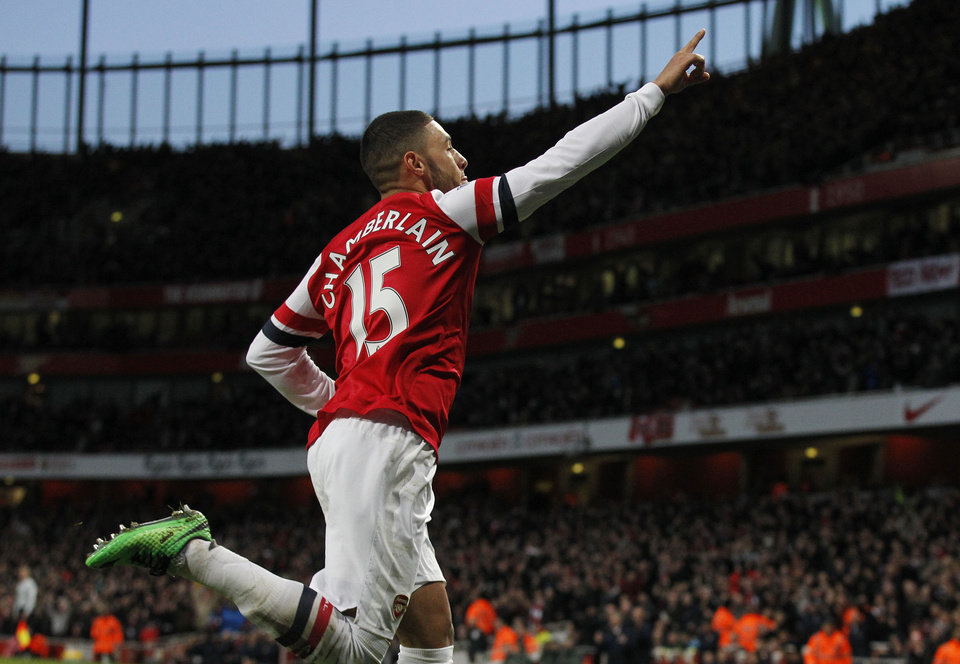 Photo - Arsenal's Alex Oxlade-Chamberlain celebrates his goal against Crystal Palace during their English Premier League soccer match at Emirates Stadium in London, Sunday, Feb. 2, 2014. (AP Photo/Sang Tan)
