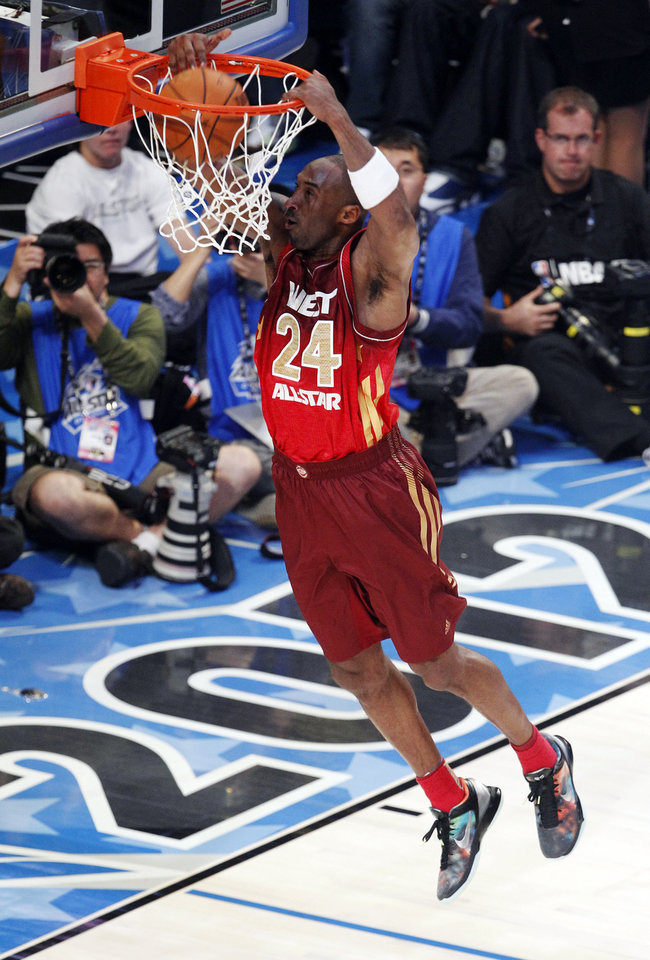 Western Conference's Kobe Bryant (24), of the Los Angeles Lakers, dunks the ball during the second half of the NBA All-Star basketball game, Sunday, Feb. 26, 2012, in Orlando, Fla. (AP Photo/Lynne Sladky) ORG XMIT: DOA141