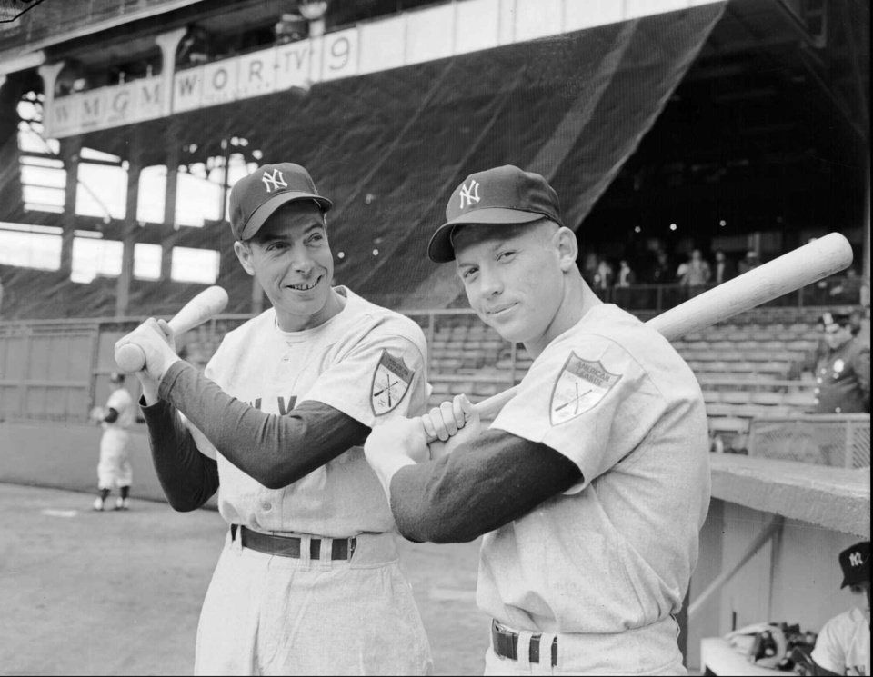 Photo - Joe DiMaggio, left, New York Yankee star centerfielder, poses with  Mickey Mantle, right, at Ebbets Field in Brooklyn, N.Y. in this April 14, 1951 photo. (AP Photo/File)