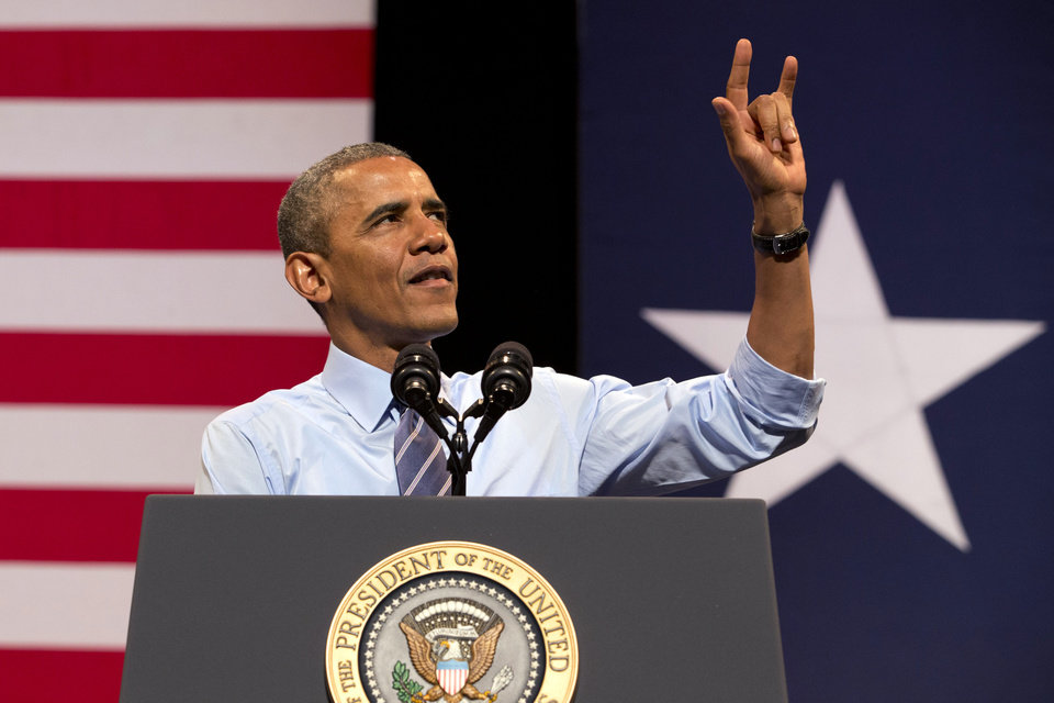 Photo - President Barack Obama gestures as he speaks at the Paramount Theatre in Austin, Texas, Thursday, July 10, 2014, about the economy. Austin is the final leg in his three city trip before returning to Washington. (AP Photo/Jacquelyn Martin)