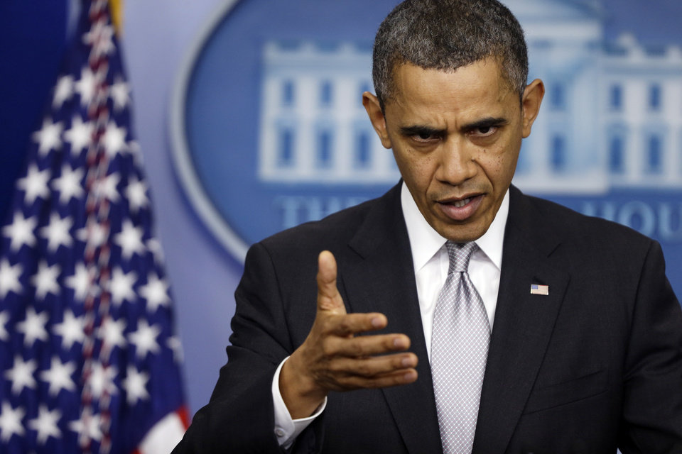 Photo - President Barack Obama gestures as he answers a question about the fiscal cliff from reporters, Wednesday, Dec. 19, 2012, at the White House in Washington. (AP Photo/Charles Dharapak)