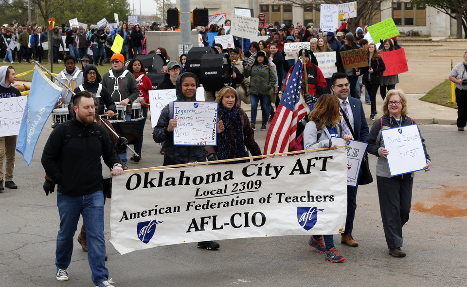 Photo - Teachers begin a walk from Northeast Academy to the Oklahoma teachers rally at the State Capitol on Monday, April 2, 2018 in Oklahoma City, Okla.  Photo by Steve Sisney, The Oklahoman