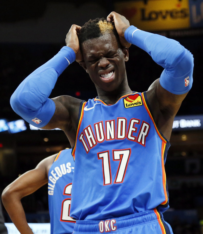 Photo - Oklahoma City's Dennis Schroder (17) reacts after Oklahoma City's Hamidou Diallo left the court with an injury to his right elbow in the fourth quarter during an NBA basketball game between the Oklahoma City Thunder and the Los Angeles Lakers at Chesapeake Energy Arena in Oklahoma City, Friday, Nov. 22, 2019. The Lakers won 130-127. [Nate Billings/The Oklahoman]