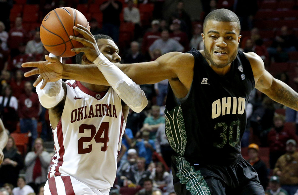 Photo - Oklahoma's Romero Osby (24) is fouled by Ohio's Reggie Keely (30) during a NCAA college basketball game between the University of Oklahoma (OU) and Ohio at the Lloyd Noble Center in Norman, Saturday, Dec. 29, 2012. Oklahoma won 74-63. Photo by Bryan Terry, The Oklahoman