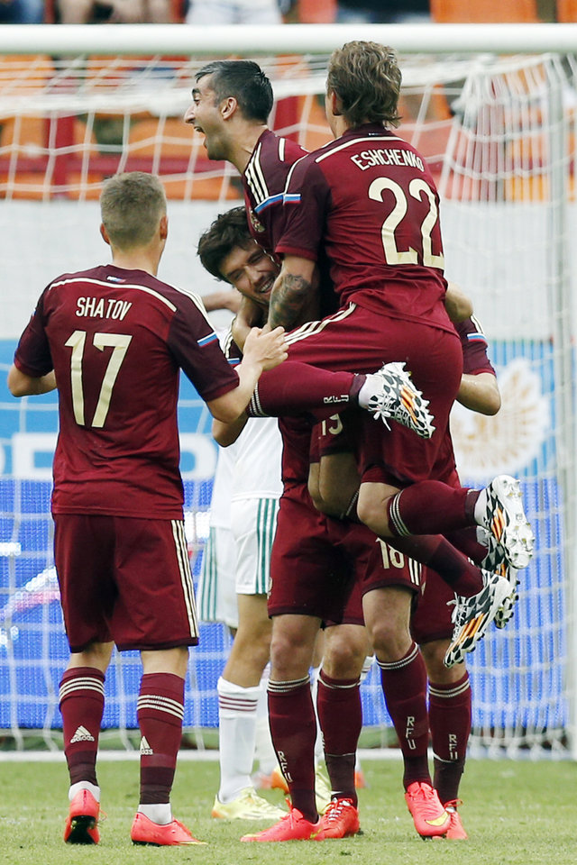 Photo - Russian national soccer team players celebrate a goal during a friendly soccer match against Morocco in Moscow, Russia, Friday, June 6, 2014. Russia won 2-0. This is the last friendly match before Russia team leave for Brazil to compete in the World Cup. (AP Photo/\Name\)