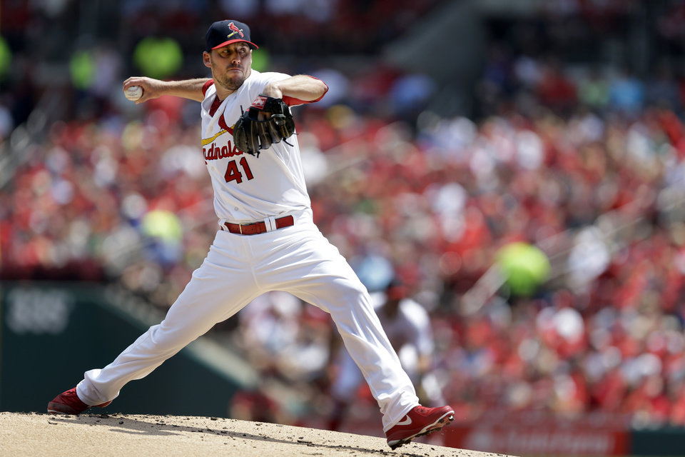 Photo - St. Louis Cardinals starting pitcher John Lackey throws during the first inning of a baseball game against the Milwaukee Brewers Sunday, Aug. 3, 2014, in St. Louis. (AP Photo/Jeff Roberson)
