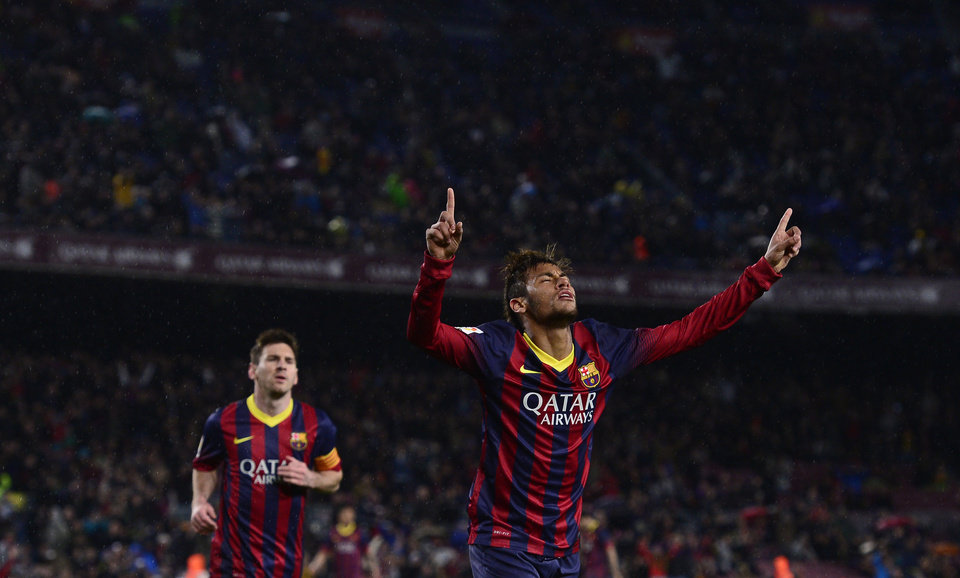 Photo - FC Barcelona's  Neymar, from Brazil, reacts after scoring against Celta Vigo during a Spanish La Liga soccer match at the Camp Nou stadium in Barcelona, Spain, Wednesday, March 26, 2014. (AP Photo/Manu Fernandez)