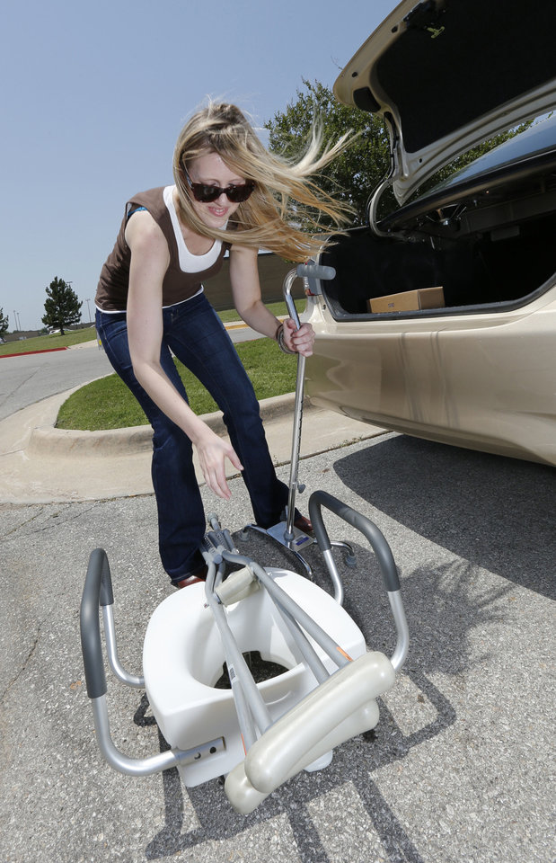 Leigh Schumacher with Portlight Strategies Inc., removes medical equipment from her car. Portlight is working with local and national organizations to help replace medical equipment for people affected by recent Oklahoma storms. <strong>STEVE SISNEY - THE OKLAHOMAN</strong>