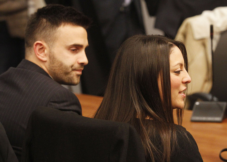 Photo - Meredith Kercher's brother Lyle, left, and sister Stephanie wait for the reading of the verdict  for the murder of the  British student in Florence, Italy, Thursday, Jan. 30, 2014. An appeals court in Florence upheld the convictions of  U.S. student Amanda Knox and her ex-boyfriend for the 2007 murder of her British roommate. Knox was sentenced to 28 1/2 years in prison, raising the specter of a long legal battle over her extradition. After nearly 12 hours of deliberation Thursday the court reinstated the guilty verdict first handed down against Knox and Raffaele Sollecito in 2009.  (AP Photo/Fabrizio Giovannozzi)