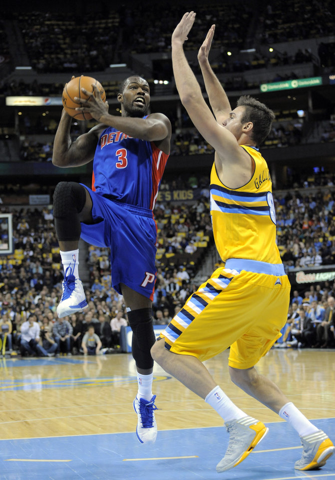 Detroit Pistons guard Rodney Stuckey (3) goes up for a shot against Denver Nuggets forward Danilo Gallinari (8), from Italy, during the first quarter of an NBA basketball game, Tuesday, Nov. 6, 2012, in Denver. (AP Photo/Jack Dempsey)