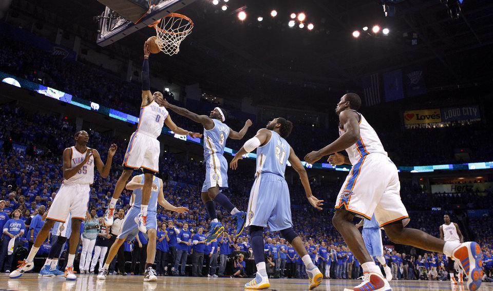 Photo - Oklahoma City's Russell Westbrook (0) lays up a shot past Denver's Ty Lawson (3) during the first round NBA playoff game between the Oklahoma City Thunder and the Denver Nuggets on Sunday, April 17, 2011, in Oklahoma City, Okla. Photo by Chris Landsberger, The Oklahoman