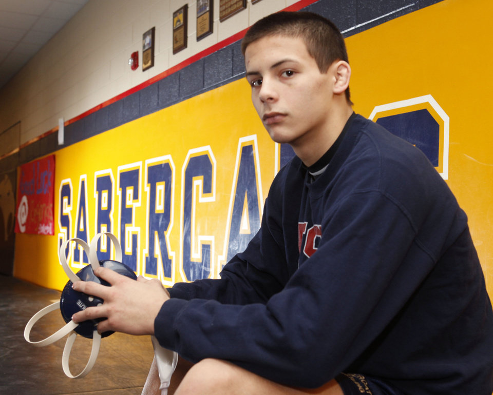 Photo - Southmoore wrestler Nathan Marek works out at the Southmoore wrestling room in Moore, OK, Monday, Feb. 20, 2012. By Paul Hellstern, The Oklahoman